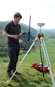 A man stood next to a GNSS base station