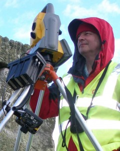 Mark stood next to a Total Station